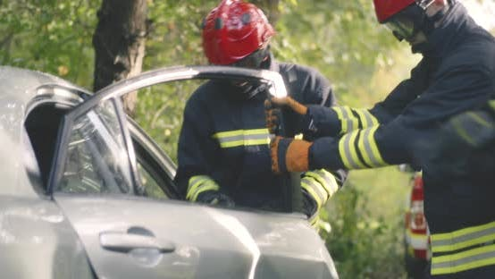 Firefighters Removing Car Door in Countryside