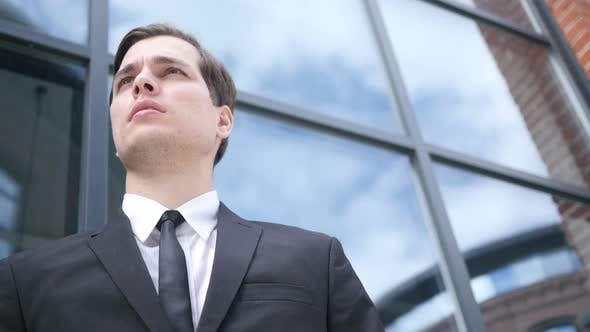 Thumbnail for Waiting Young Businessman, Looking and Waiting for Opportunity