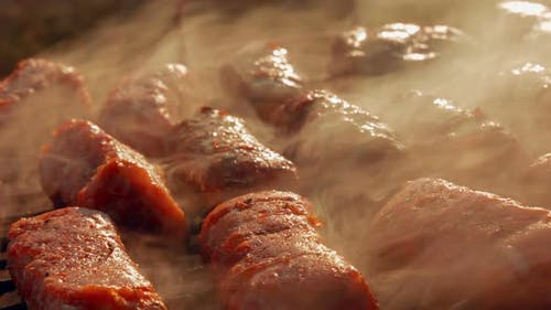 Ultra Close-up Barbecue (BBQ) Shot Showing Pork and Beef Meat Rolls