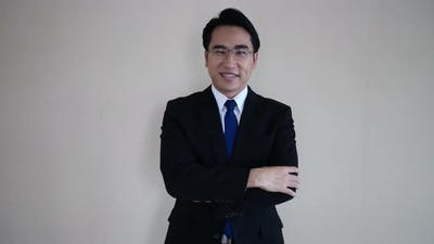 businessman facing camera. wearing glasses.