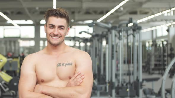 Thumbnail for Portrait of Young Sports Guy in the Gym Looking at Camera