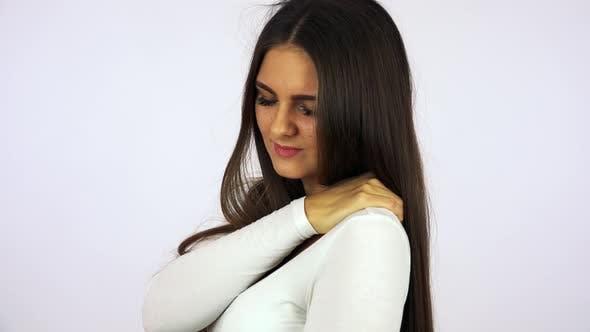 A Young Beautiful Woman Has a Neckache - Closeup - White Background