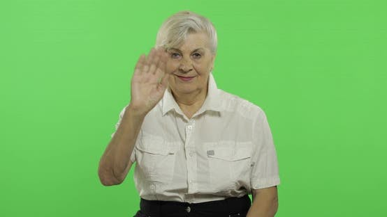 Thumbnail for An Elderly Woman Waving To Camera and Smiles. Old Grandmother. Chroma Key
