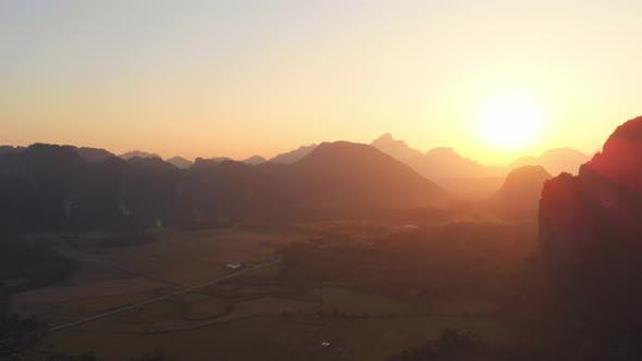 Aerial: Vang Vieng backpacker travel destination in Laos, Asia.
