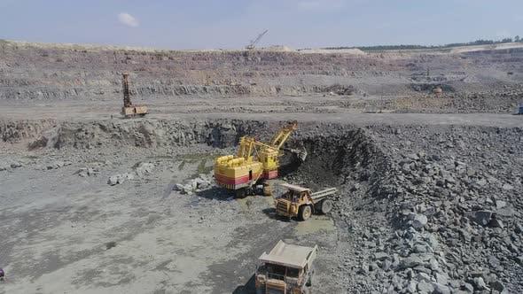Thumbnail for Big Excavator Loading Granite Into Heavy Dump Truck