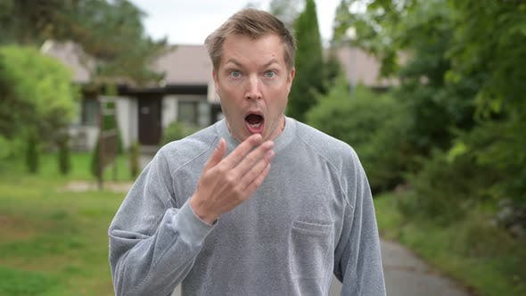 Cover Image for Young Handsome Man Looking Surprised And Covering Mouth At Home Outdoors