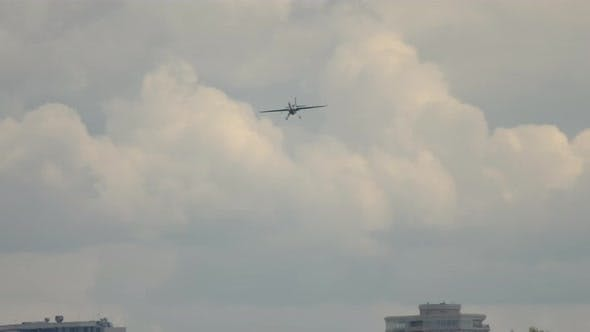 Sports Airplane Stunts Over the City