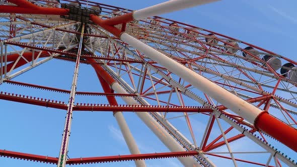 Thumbnail for Ferris Wheel Rotates Against the Sky in Summer Day