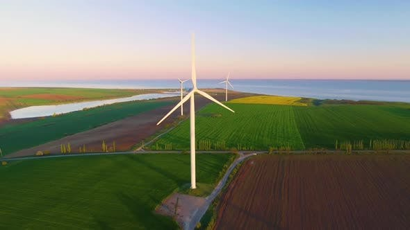 Thumbnail for Wind Turbine Farm on Beautiful Evening Landscape. Renewable Energy Production for Green Ecological