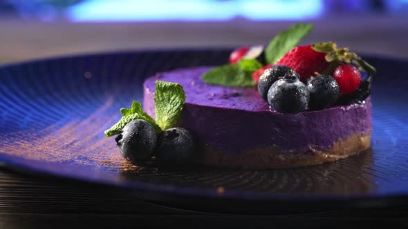 Cover Image for Purple Cheesecake with Berries on Plate.