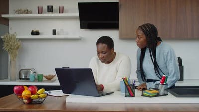 Busy African Mom Ignoring Depressed Teenage Daughter