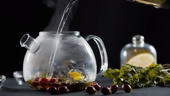Thumbnail for Pouring Boiling Water Into a Teapot with Herbs, Fruits and Tea, Hot Beverage,