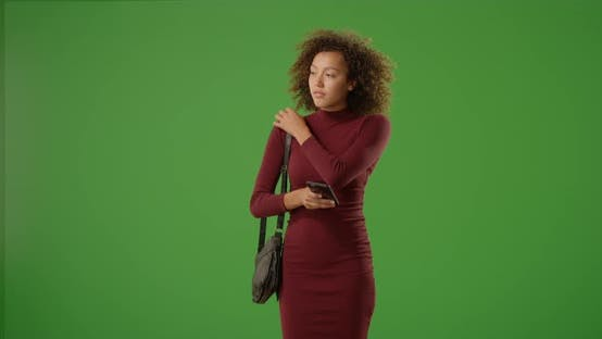 Thumbnail for Slender young African woman waiting for date outdoors for date on green screen