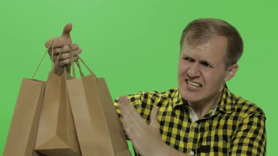 Thumbnail for Angry Aggressive Young Man with Shopping Bags. Chroma Key