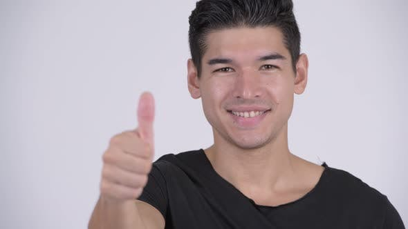 Thumbnail for Face of Happy Young Handsome Multi-ethnic Man Giving Thumbs Up
