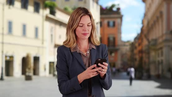 Thumbnail for Businesswoman in Rome texting with cellphone