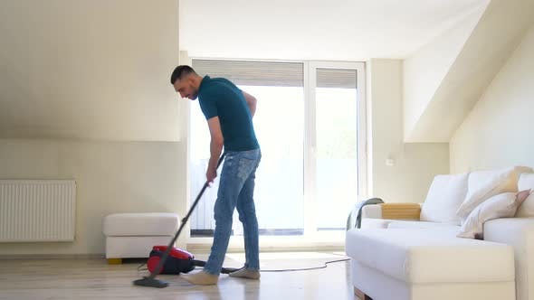 Thumbnail for Man with Vacuum Cleaner at Home 33