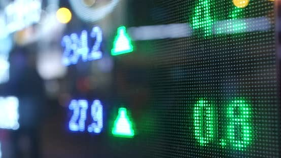 Cover Image for Stock market display screen in the city at night