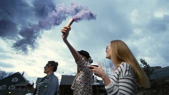 Cover Image for Three Hipsters Dance Outdoors with Flare