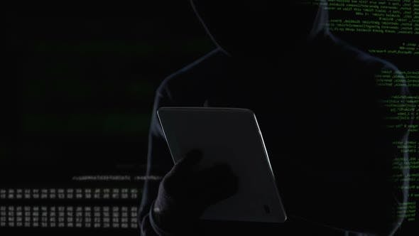 Thumbnail for Dark Man Typing on Tablet Computer, Illegal Attack on Privacy, Cybercrime
