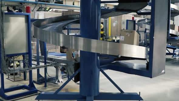 Thumbnail for Production Line On Which The Boxes Move In A Spiral