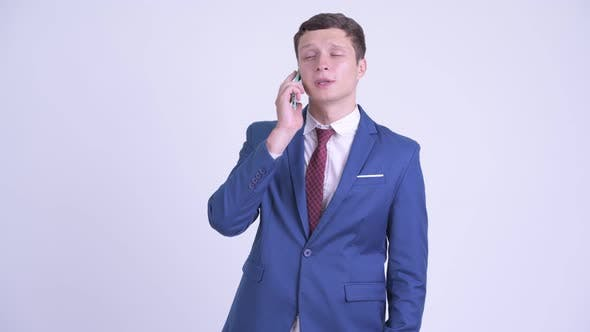 Cover Image for Happy Young Handsome Businessman Talking on the Phone