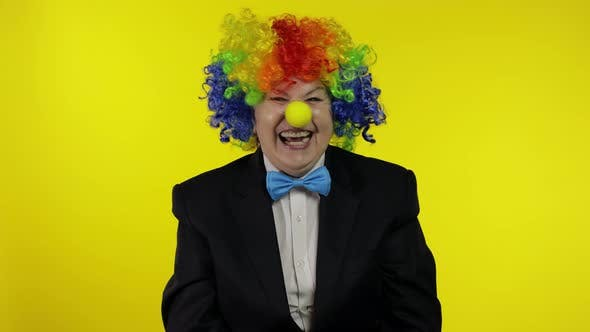 Thumbnail for Senior Old Woman Clown in Colorful Wig Smiling, Fool Around, Laughing. Halloween