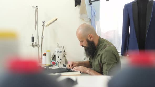 Thumbnail for Tailor marking the fabric
