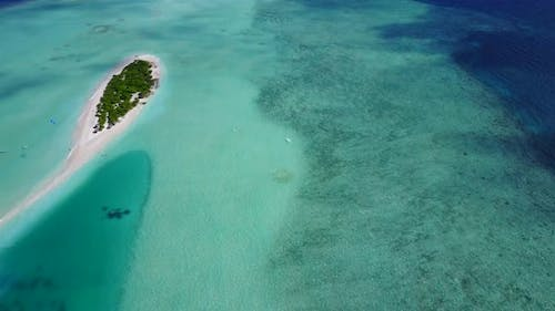 Daytime aerial abstract view of a paradise sunny white sand beach and aqua blue water background in