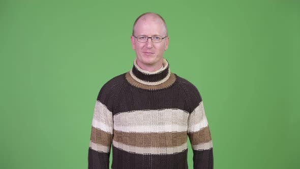 Thumbnail for Happy Mature Bald Man Smiling While Wearing Turtleneck Sweater