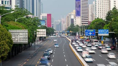 Timelapse Heavy Traffic on Shenzhen Highway with Road Signs