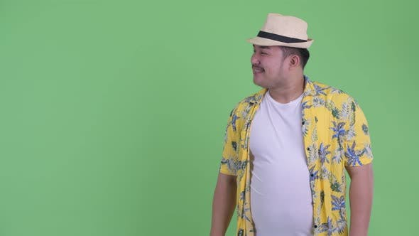 Thumbnail for Happy Young Overweight Asian Tourist Man Snapping Fingers and Giving Thumbs Up