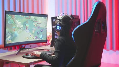 Young Girl Wearing Headphones Playing Video Game