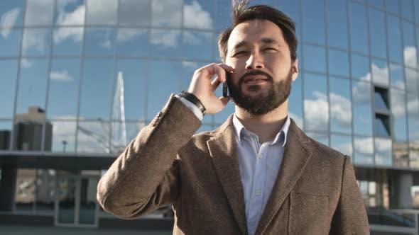 Thumbnail for Asian Entrepreneur Talking on Cell Phone