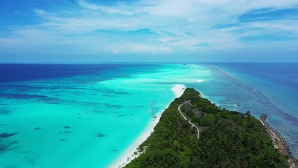 Thumbnail for Tropical overhead tourism shot of a white paradise beach and blue water background