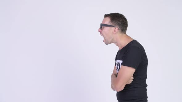 Cover Image for Profile View of Angry Nerd Man Shouting