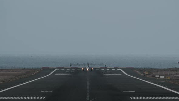 Thumbnail for Airplane Taking Off From Airport By the Ocean