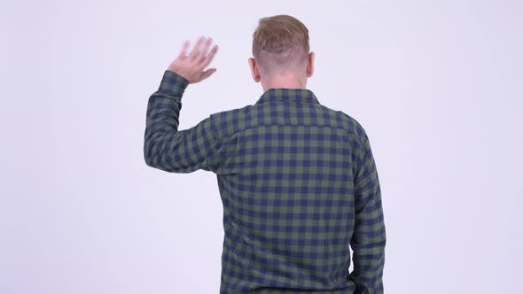 Thumbnail for Rear View of Blonde Hipster Man Waving Hand
