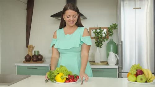 Young Charming Woman Tasting Healthy Food Expressing Enjoyment at Home