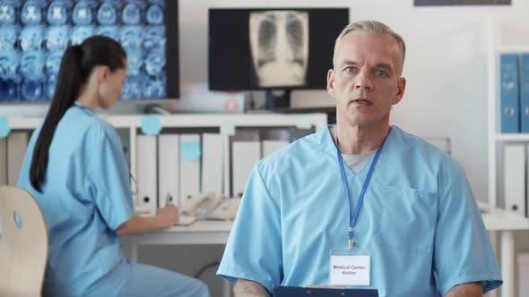 Doctor Consulting Unrecognizable Patient