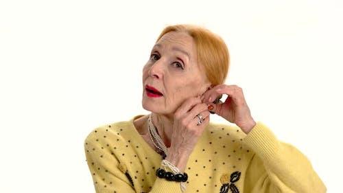 Woman Fixing Earrings