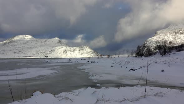 Thumbnail for Winter Lake and Heavy Clouds