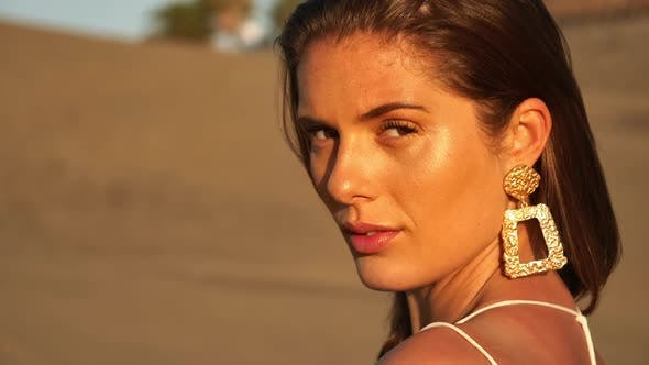 Closeup Shot of Beautiful Model with Sand Dunes in Background