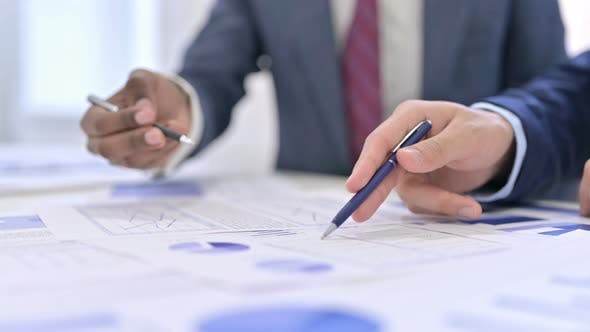 Thumbnail for Business People Working on Documents, Business Report