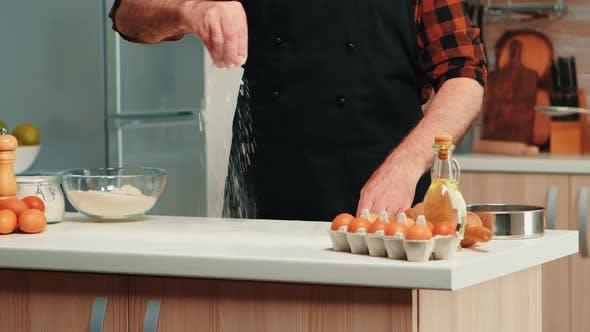 Thumbnail for Mature Baker Using Flour