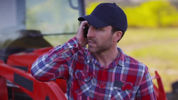 Farmer talking on cell phone