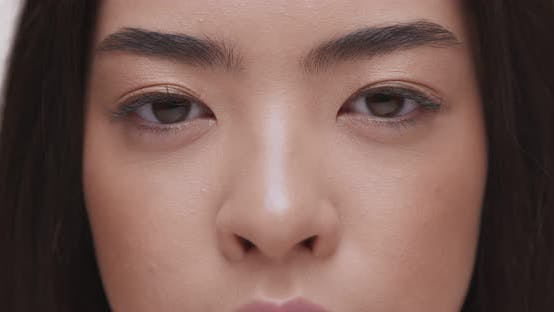 Thumbnail for Close Up Portrait of Young Asian Woman Looking To Camera