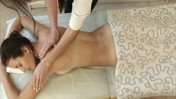 Thumbnail for Beautiful Young Woman Having Back Massage in a Spa Salon