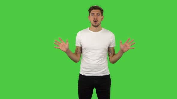 Cover Image for Confident Frustrated Guy Is Saying Wow with Shocked Facial Expression. Green Screen
