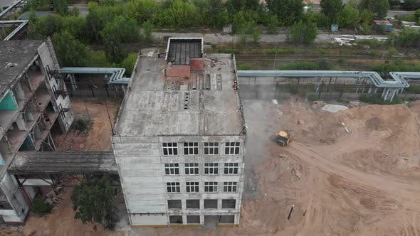 Two Empty Abandoned Buildings Near the Construction Site